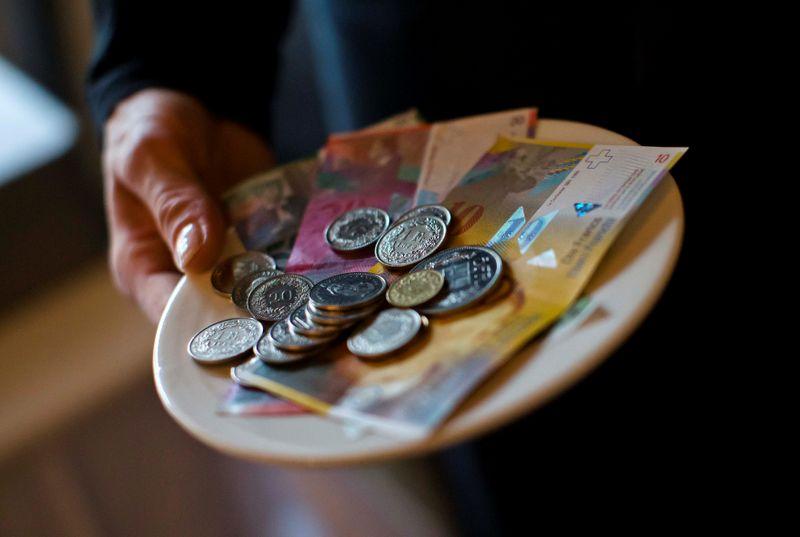 Swiss franc holds gains, Yen steady as traders eye Iran